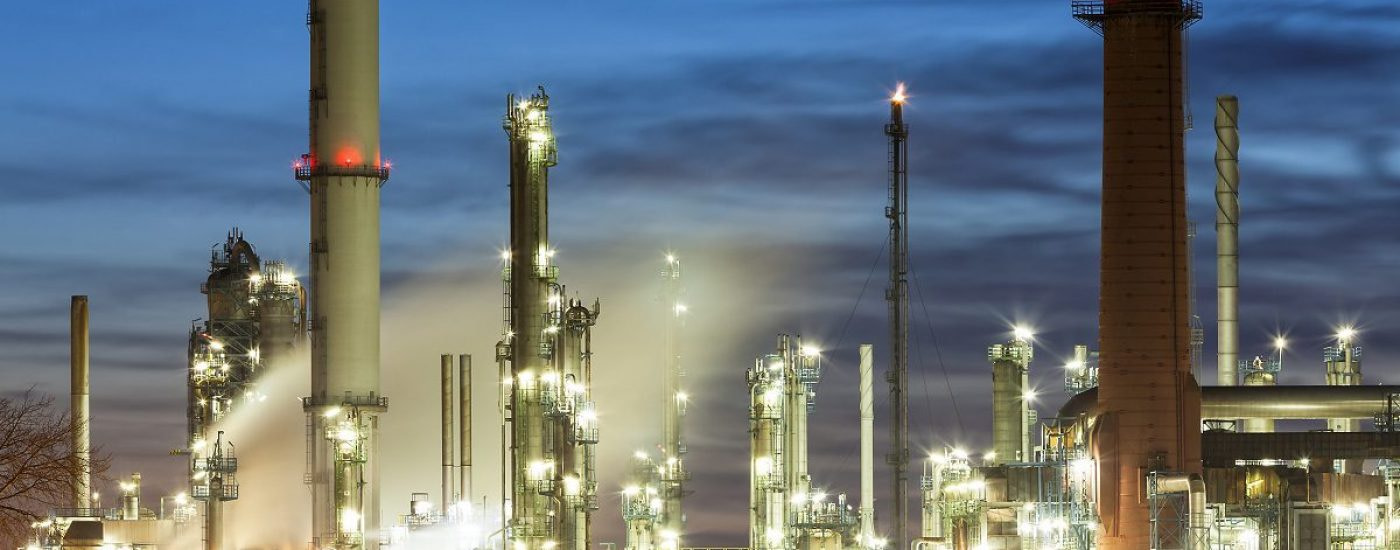 Petrolchemical plant and refinery complex at dusk, Germany.